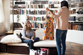 istock Woman showing a friend her new dress 457207747