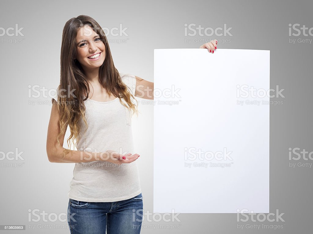 Woman showing a white board stock photo