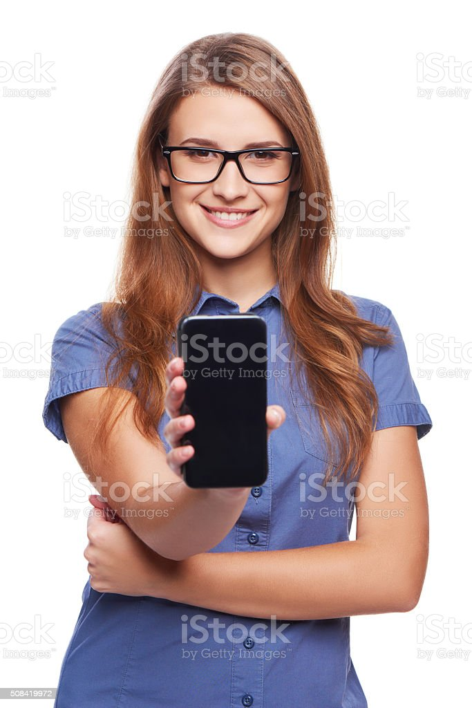 Woman showing blank black smart phone screen stock photo