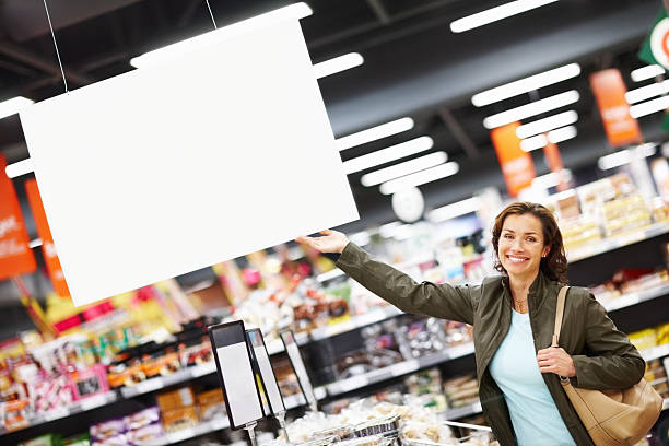 Woman showing blank board stock photo