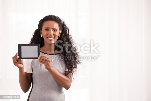 863476166 istock photo Woman showing blank electronic book. 658509608