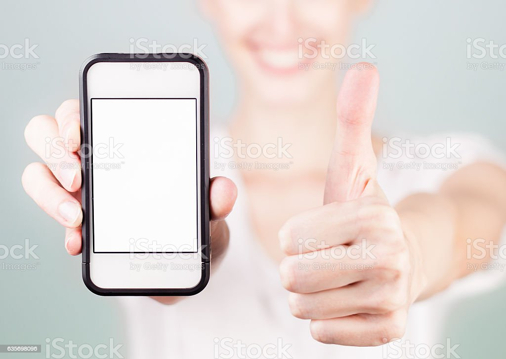 Woman showing blank smart phone with thumbs up royalty-free stock photo