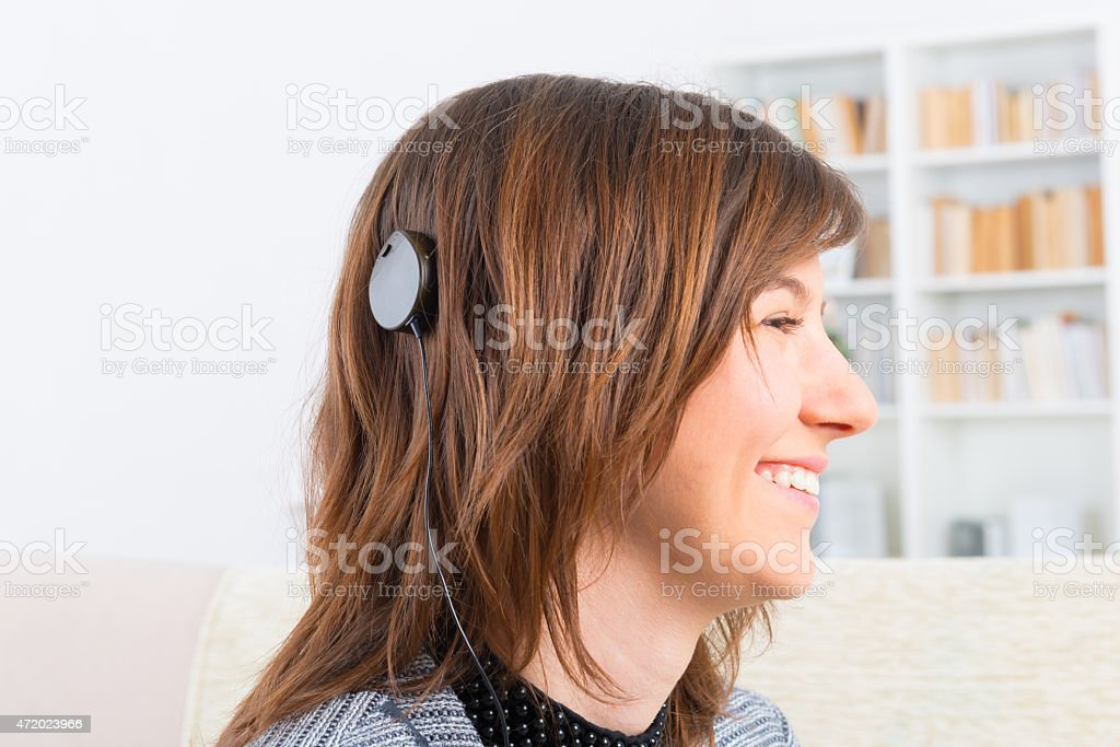 Woman showing cochlear implant stock photo