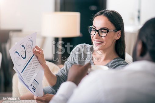 istock Woman showing diagram to her colleague 542695916