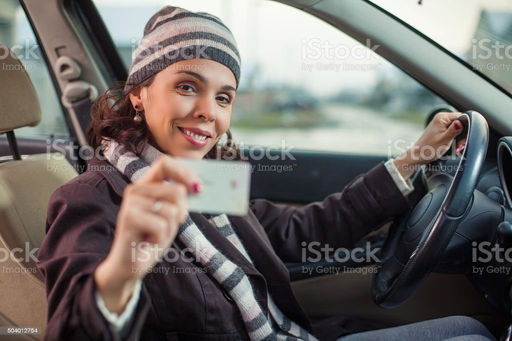 Woman Showing Driver's License stock photo