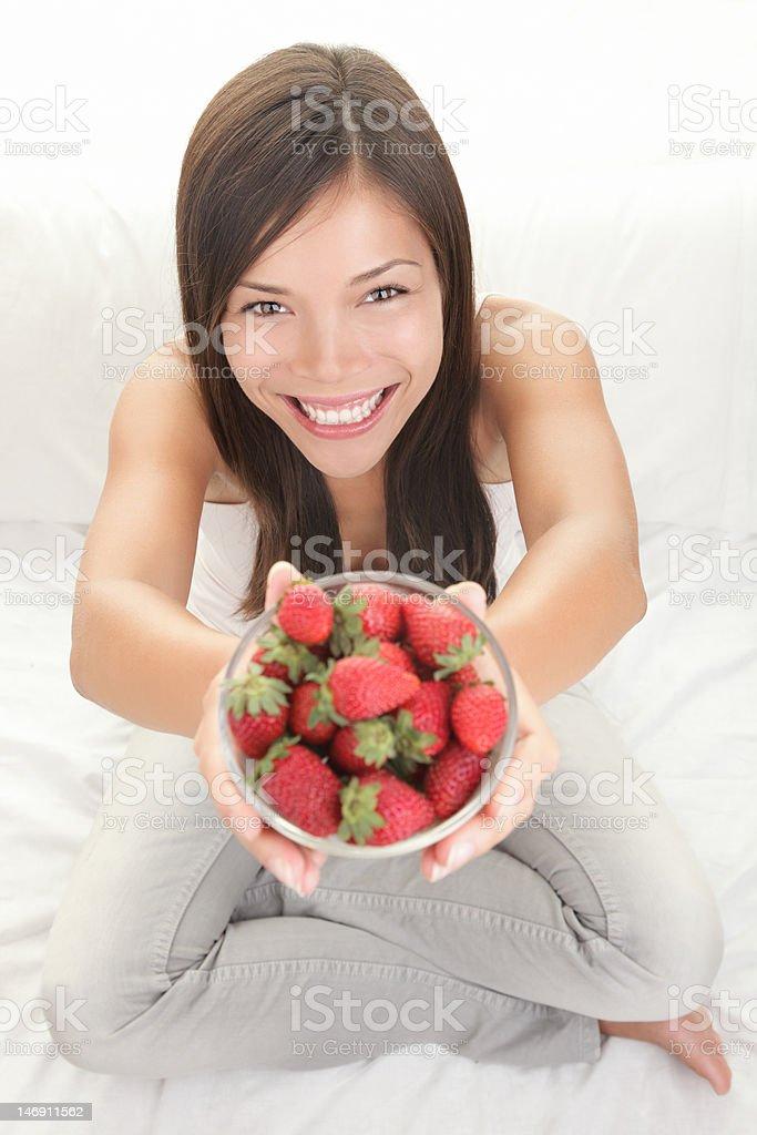 Woman showing fresh strawberries royalty-free stock photo