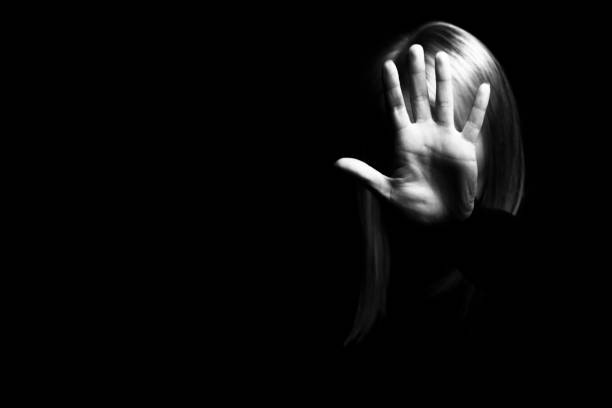 a woman showing gesture stop. violence against women concept. - donna si nasconde foto e immagini stock