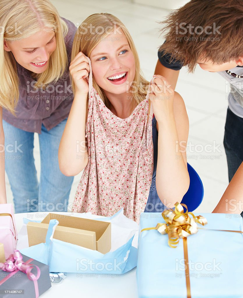 Woman showing gifts to her friends royalty-free stock photo