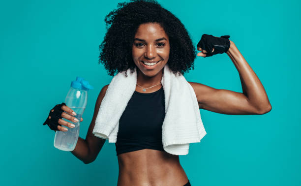 Woman showing her muscles stock photo