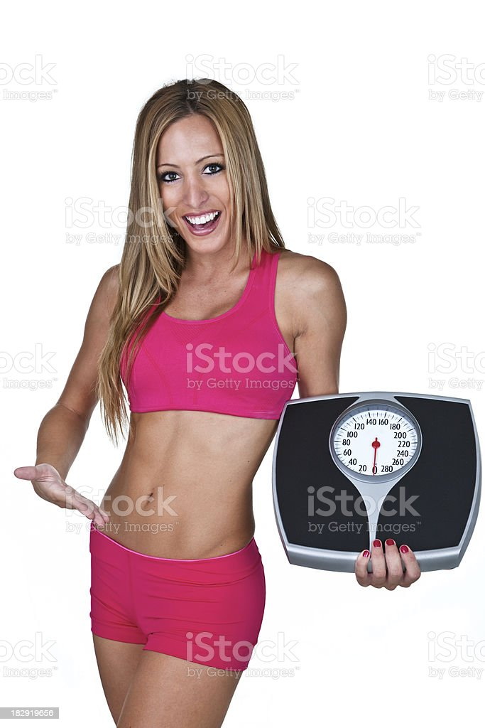 Woman showing her weight loss results royalty-free stock photo