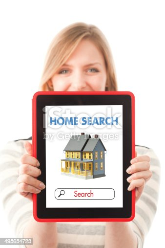 Searching for new home on-line using internet web real estate listing on a digital tablet computer.