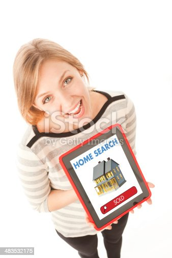 Happy woman showing the sale of her home on a real estate website with her tablet computer.