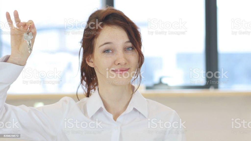 Woman Showing House Keys stock photo