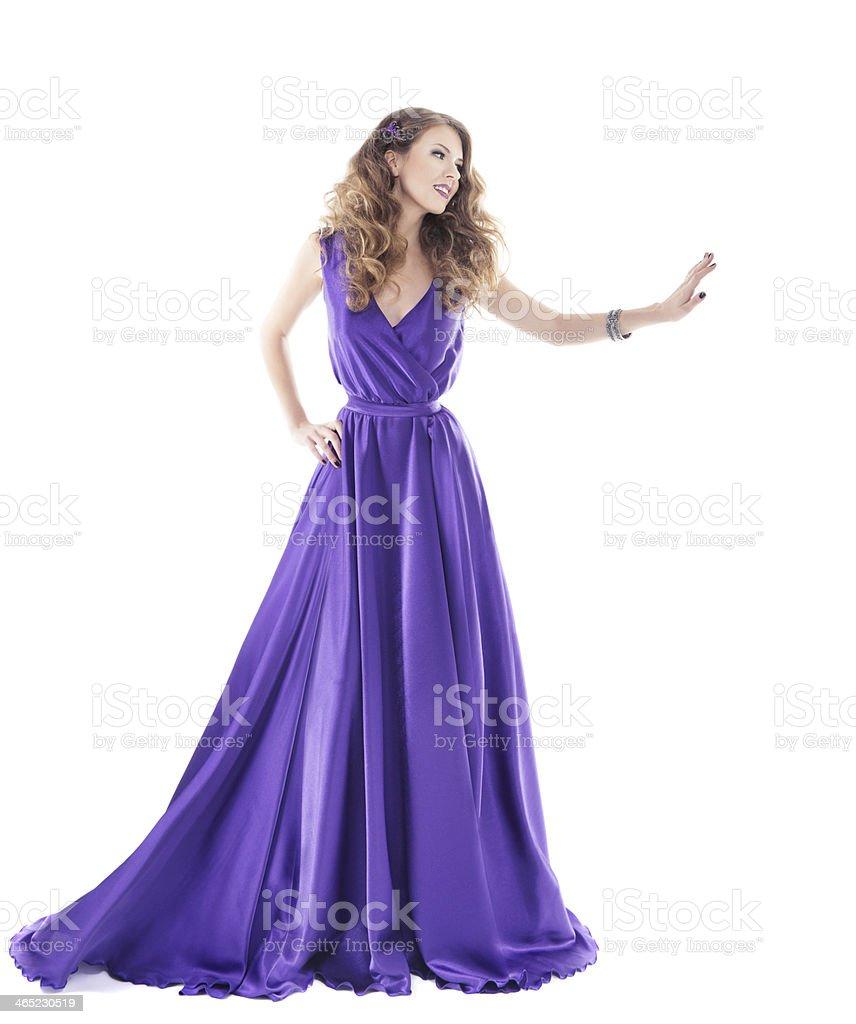 Woman showing in purple silk dress stock photo