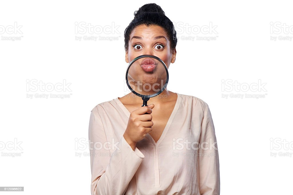 Woman showing lips folded for kiss stock photo