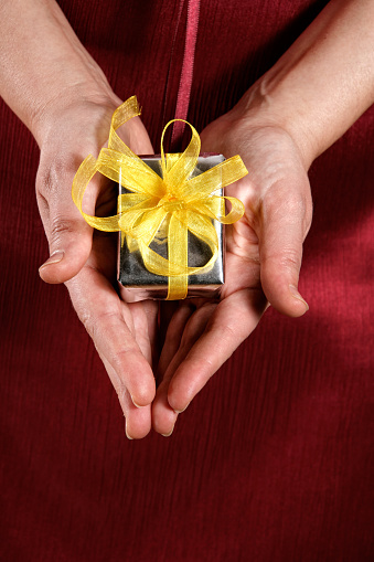Woman showing little gift box
