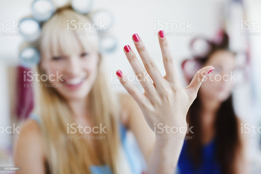Woman showing off manicure stock photo