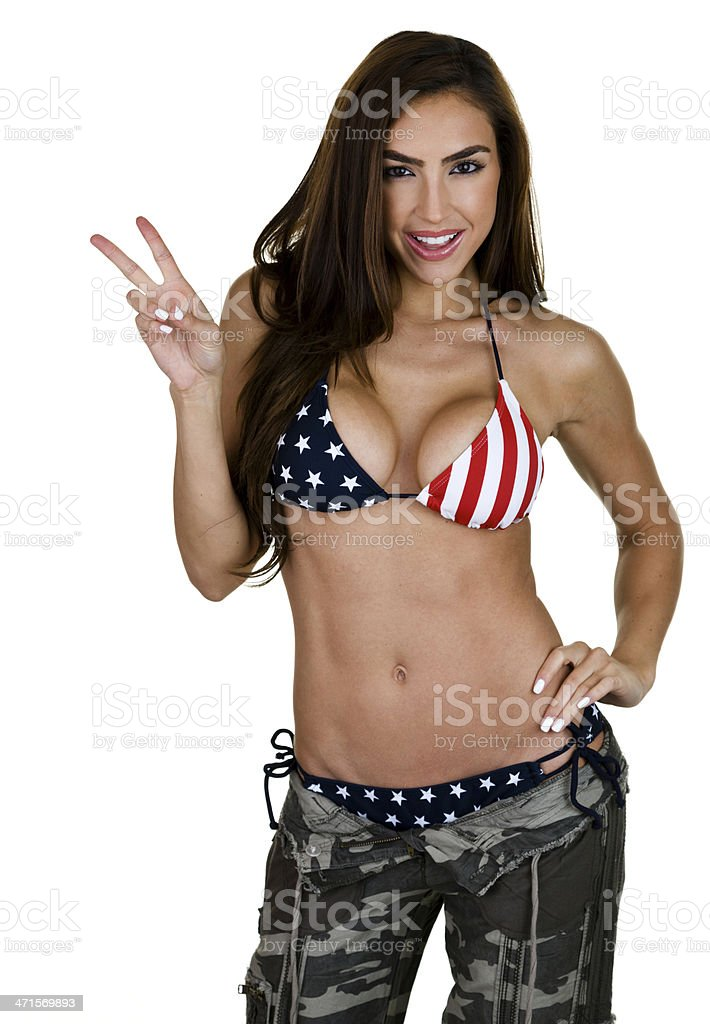 Woman showing peace sign stock photo