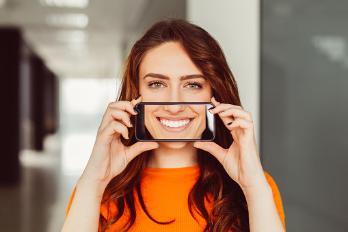 Woman showing perfect toothy selfie stock photo