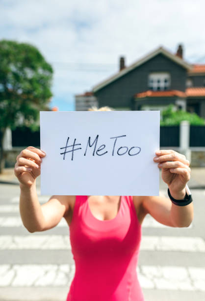 Woman showing poster with metoo hashtag stock photo