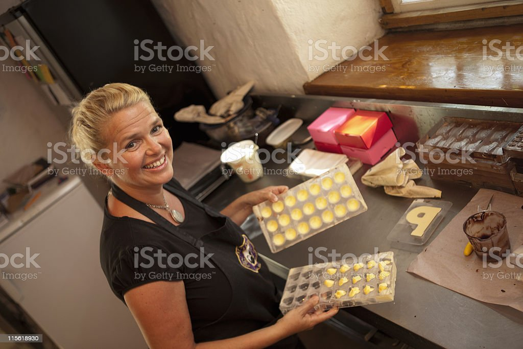 Woman showing praline forms stock photo