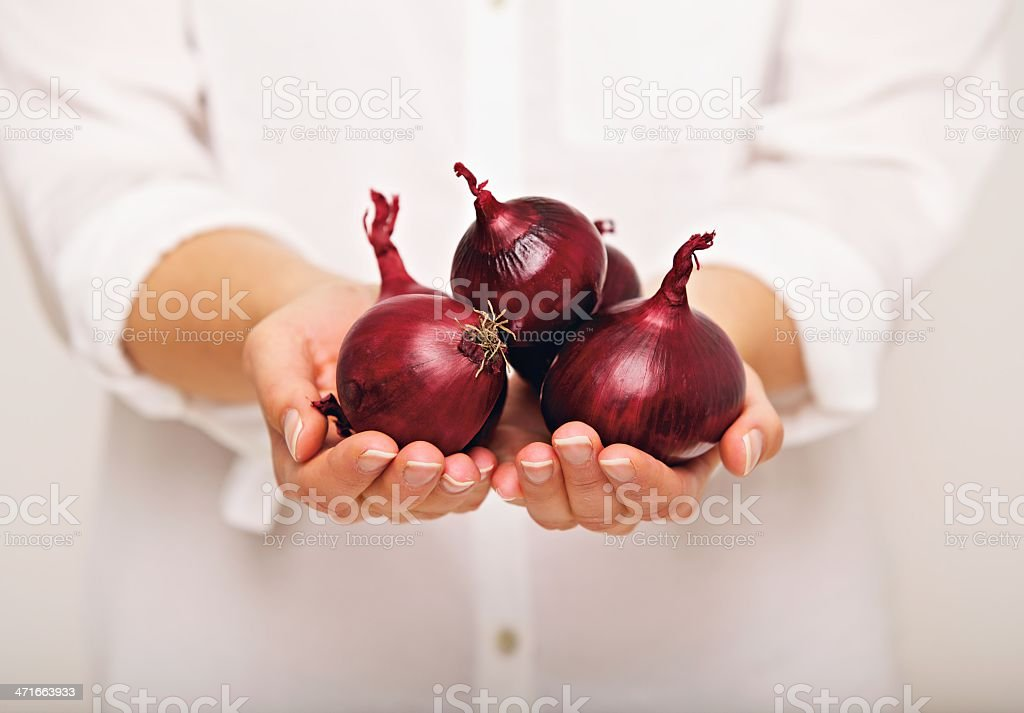 Woman Showing Red Onions royalty-free stock photo
