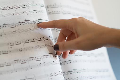 Woman showing Sheet Music