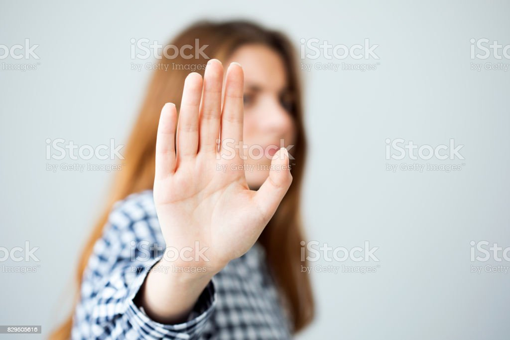 Woman showing stop gesture stock photo