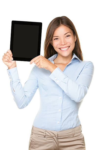 Woman showing tablet computer Note to the editor: the original logo on the button and design features have been removed and replaced by a generic power button. touchpad stock pictures, royalty-free photos & images