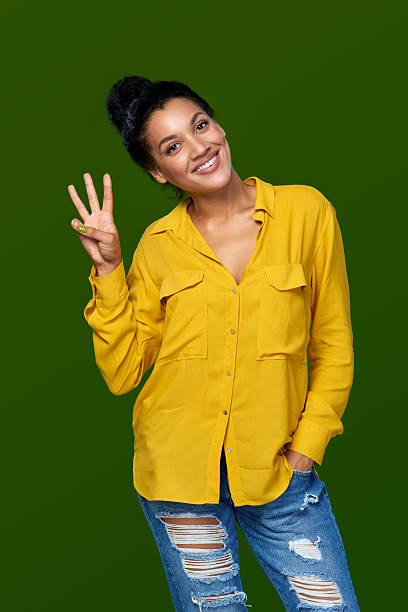woman showing three fingers - number 3 stock photos and pictures