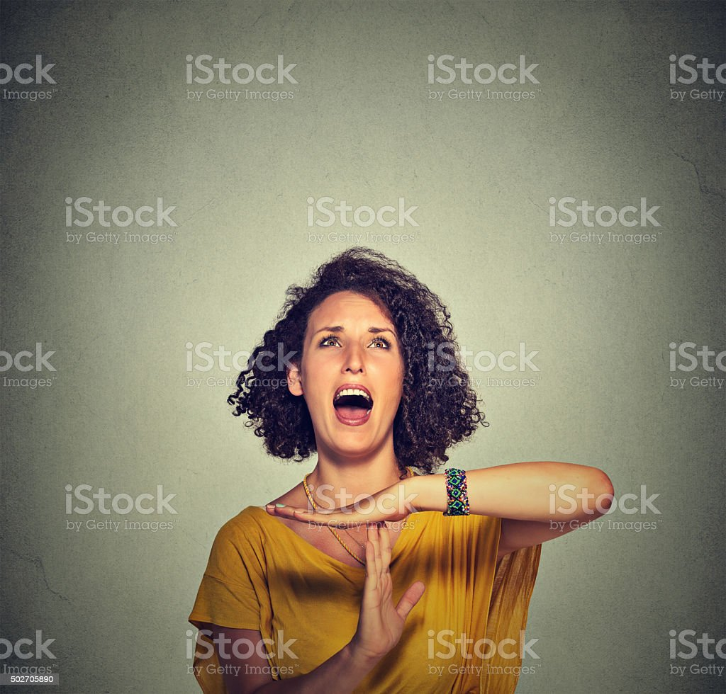 Woman showing time out hand gesture, frustrated screaming stock photo