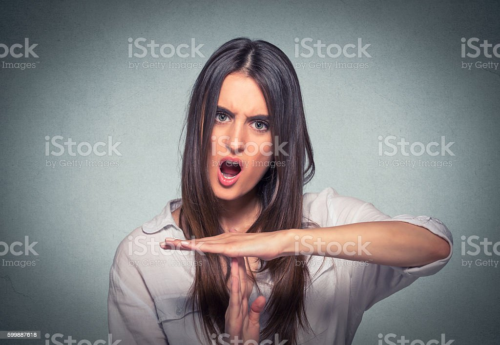 Woman showing time out hand gesture screaming stock photo