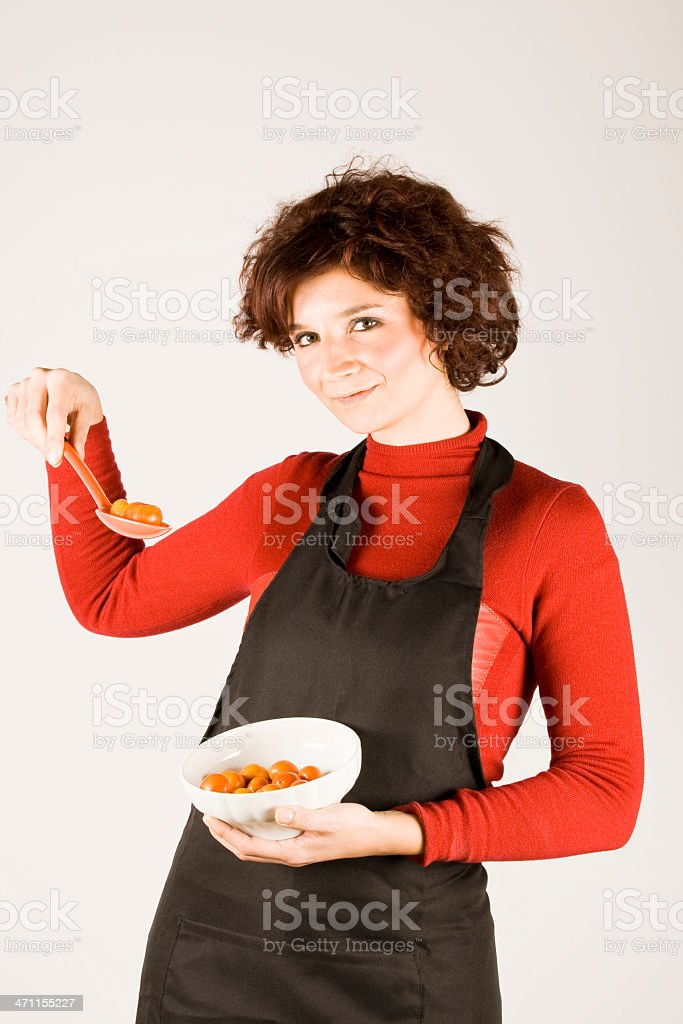 Woman showing tomatoes royalty-free stock photo