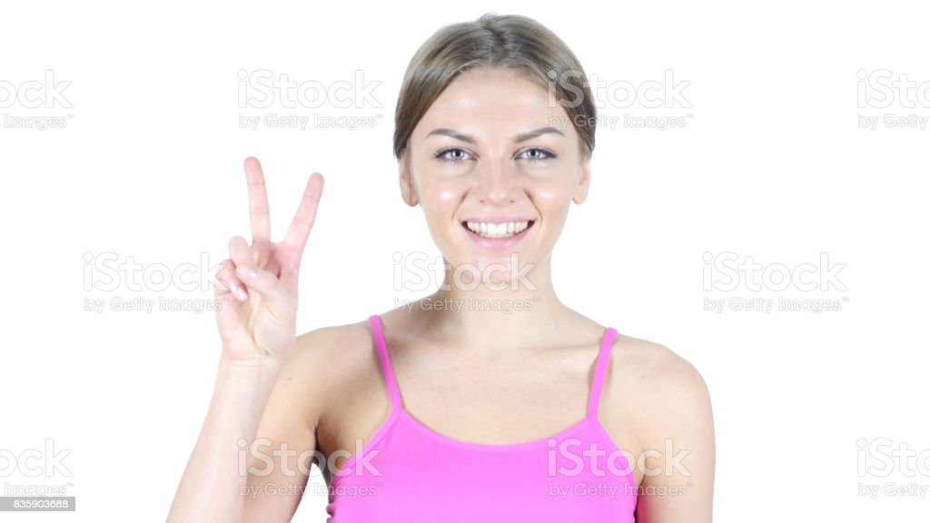 Woman Showing Victory Sign, White Background stock photo