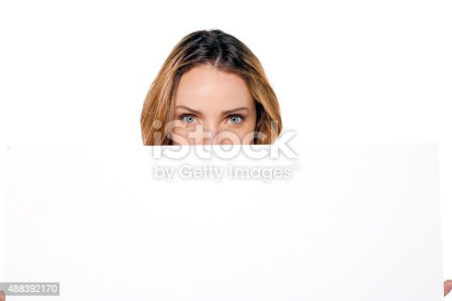 istock Woman showing whiteboard 488392170