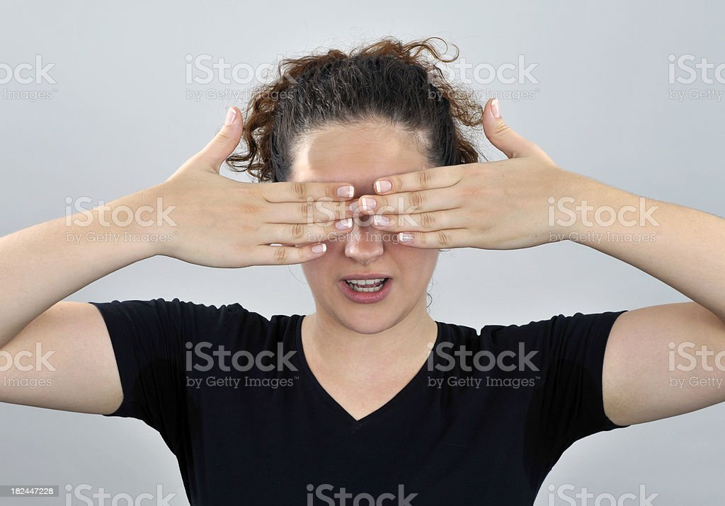 Woman shows emotion seeing  nothing. See more royalty-free stock photo