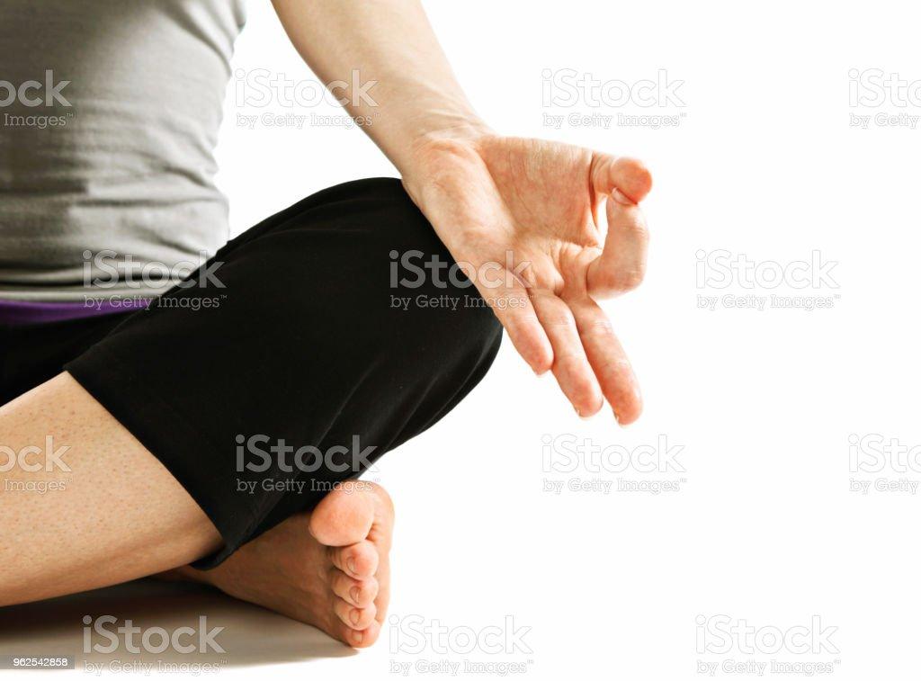 Mulher mostra intensa alongamento ou Uttanasana uma pose de ioga - Foto de stock de Abstrato royalty-free