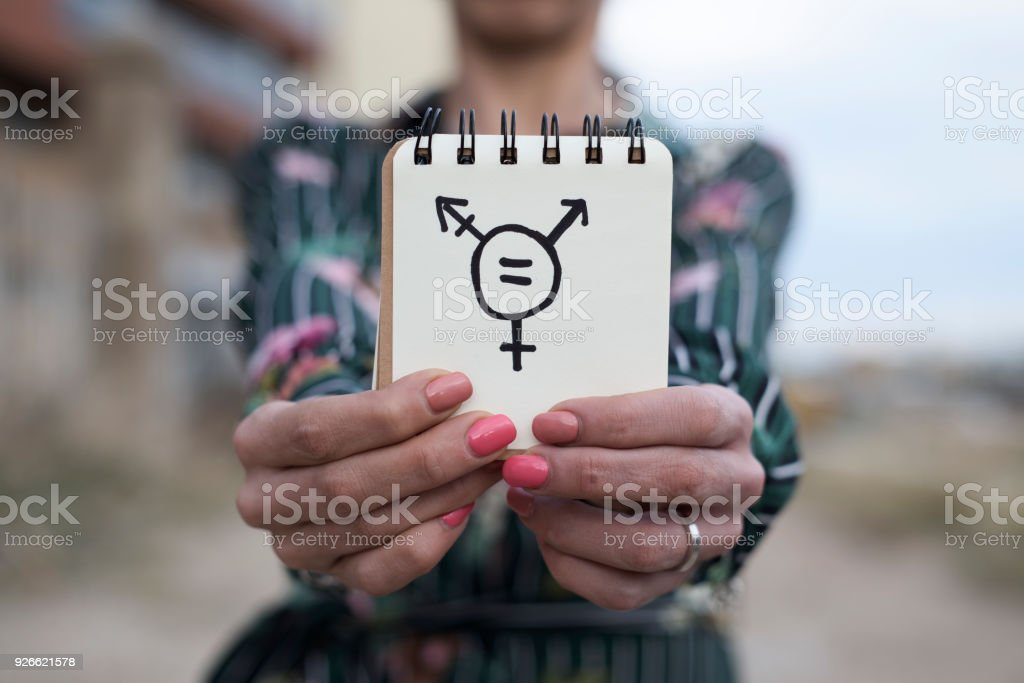 woman shows notepad with a transgender symbol stock photo