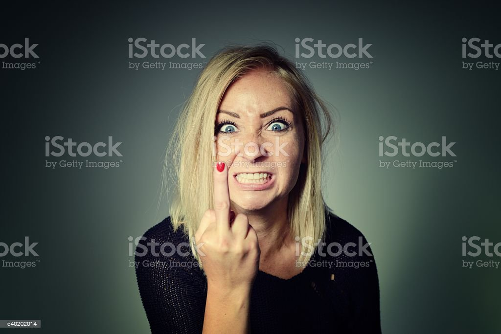 Woman shows sign of fuck off. stock photo