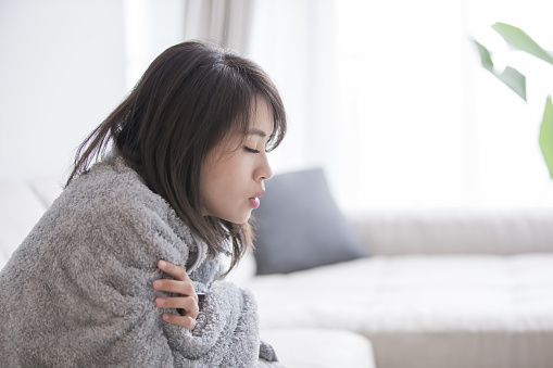 woman sick and feel cold
