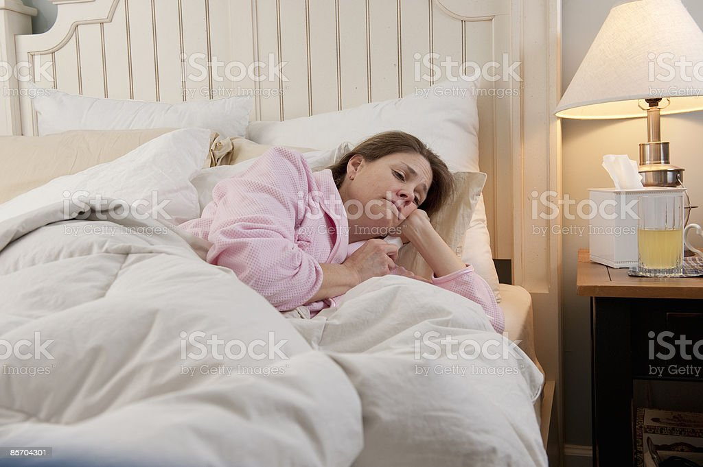 Woman Sick in Bed royalty-free stock photo