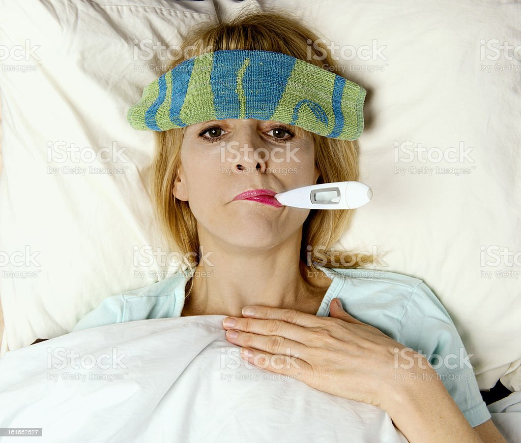 Woman sick with thermometer in mouth royalty-free stock photo