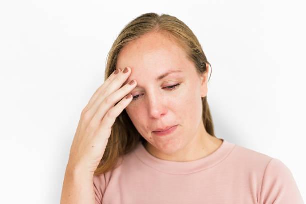 kvinna sjukdom huvudvärk kall feber concept - mature woman fever on white bildbanksfoton och bilder