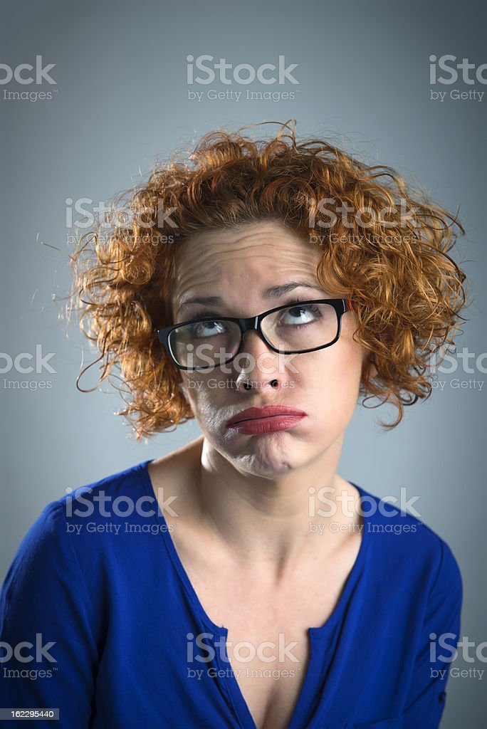 woman sighing stock photo