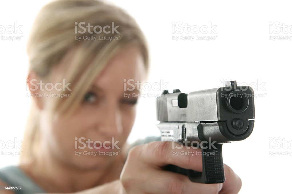 Woman sighting her firearm royalty-free stock photo