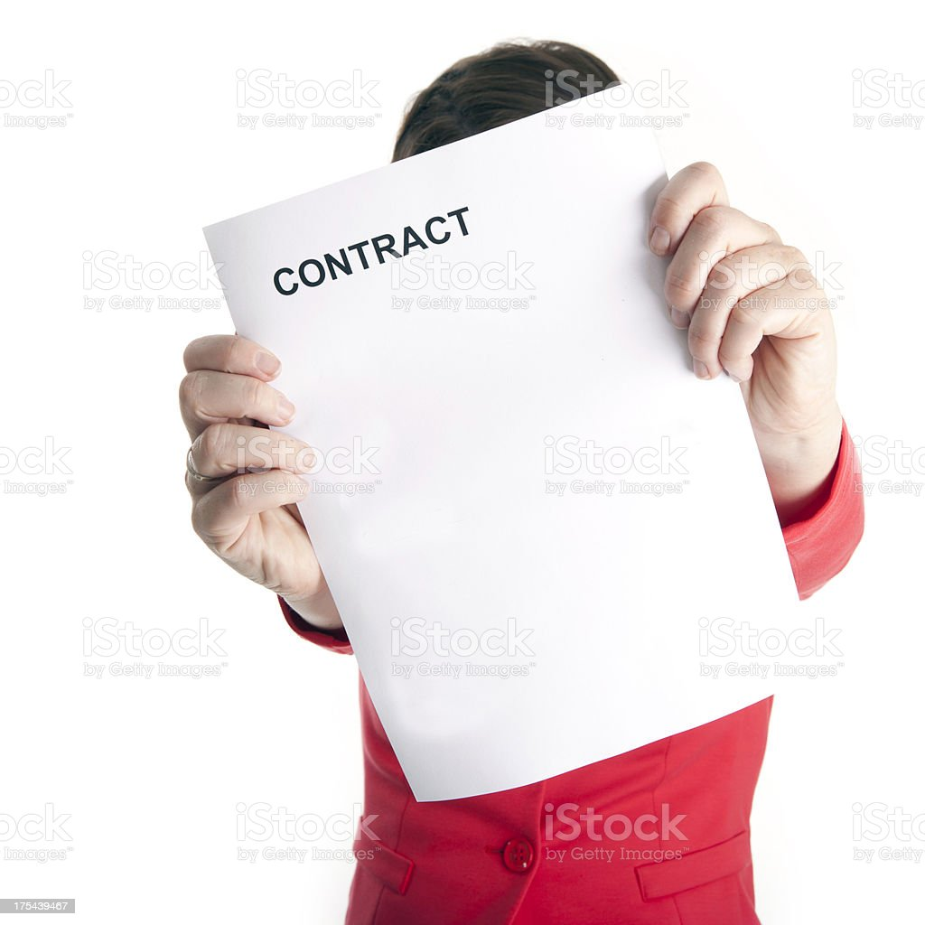 woman signing a contract stock photo