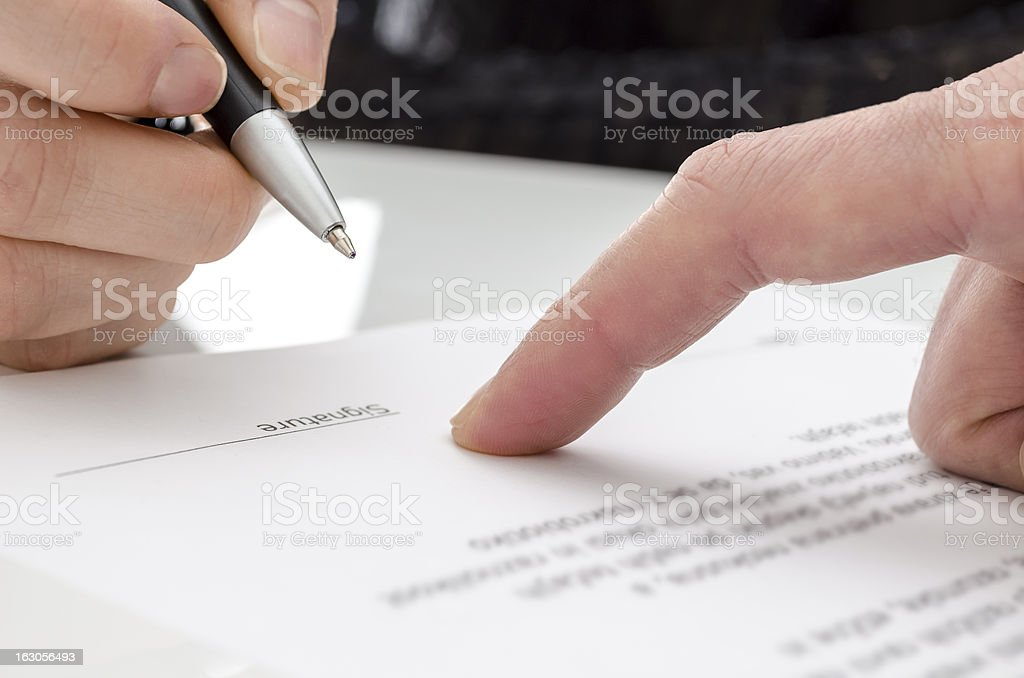 Woman signing a paper royalty-free stock photo
