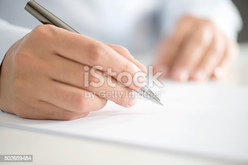 istock Woman Signing Contract Paper 502659484