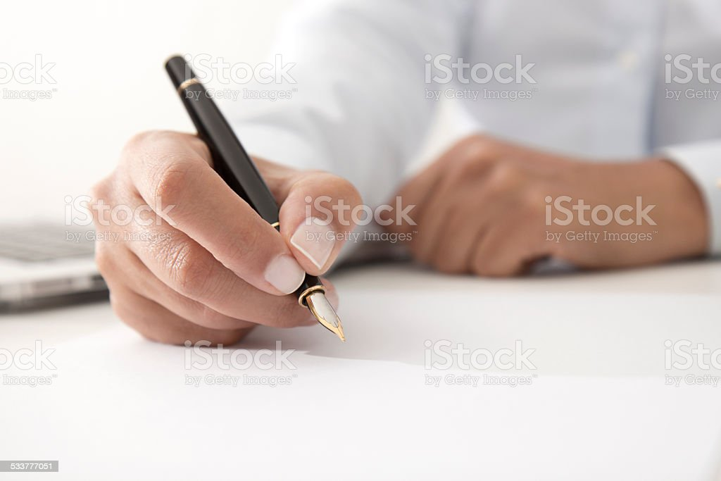 Woman Signing Contract Paper stock photo