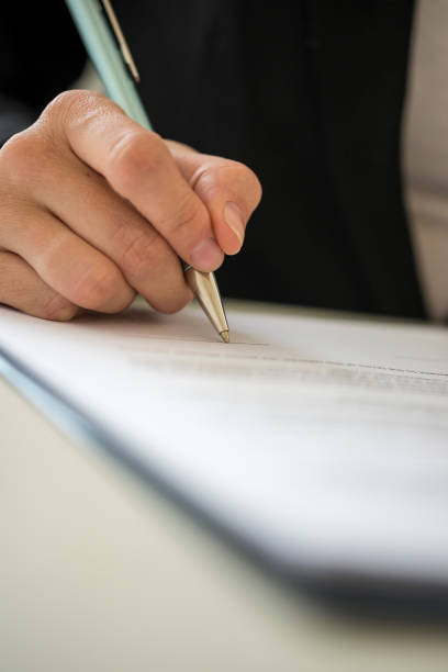 Woman signing contract stock photo